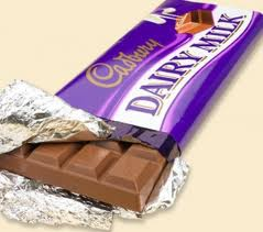 Dairymilk chocolate bar partially unwrapped