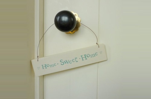 Home Sweet Home sign hanging on door