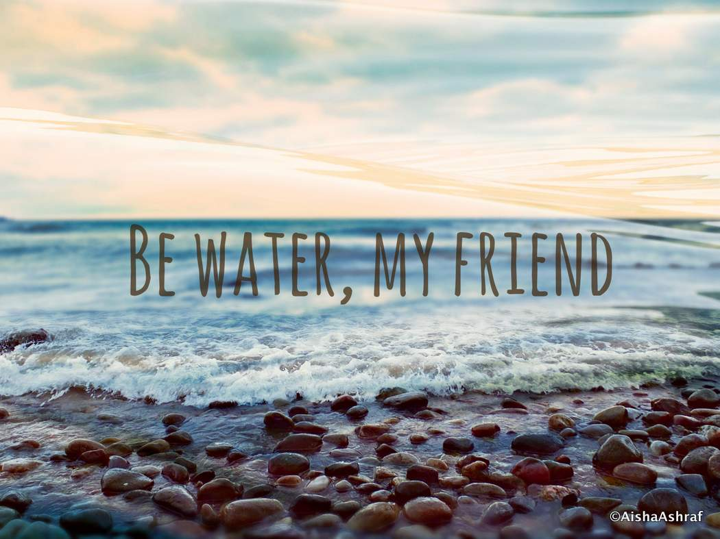 Waves on a shore: Be Water text