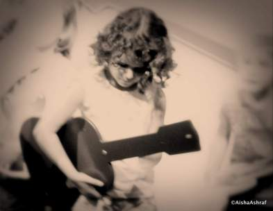 Small girl with guitar in soft focus