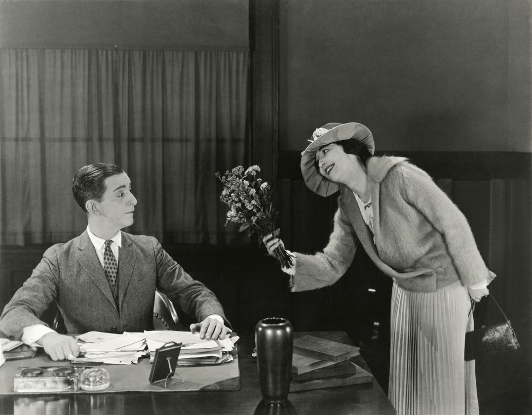 Black and white, woman offering man flowers