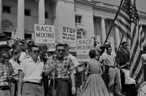 Black and white image of a crowd protesting race mixing in the US