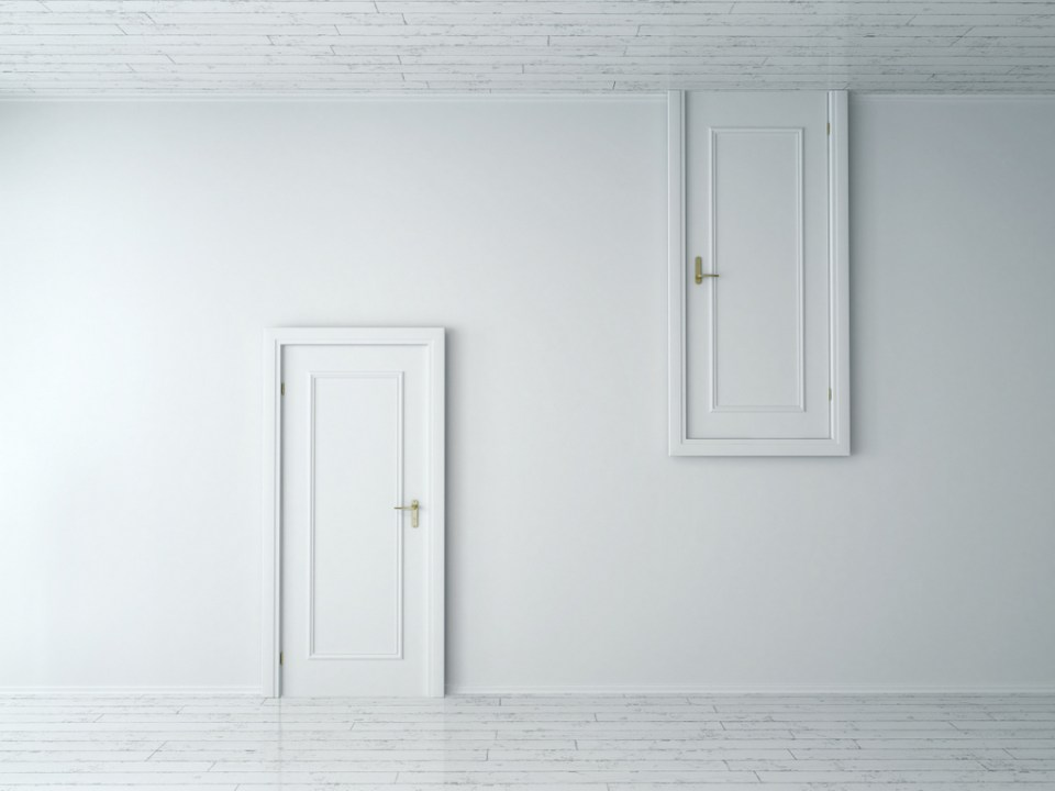 Two white doors in a white wall, one opens from the ceiling, the other from the floor.
