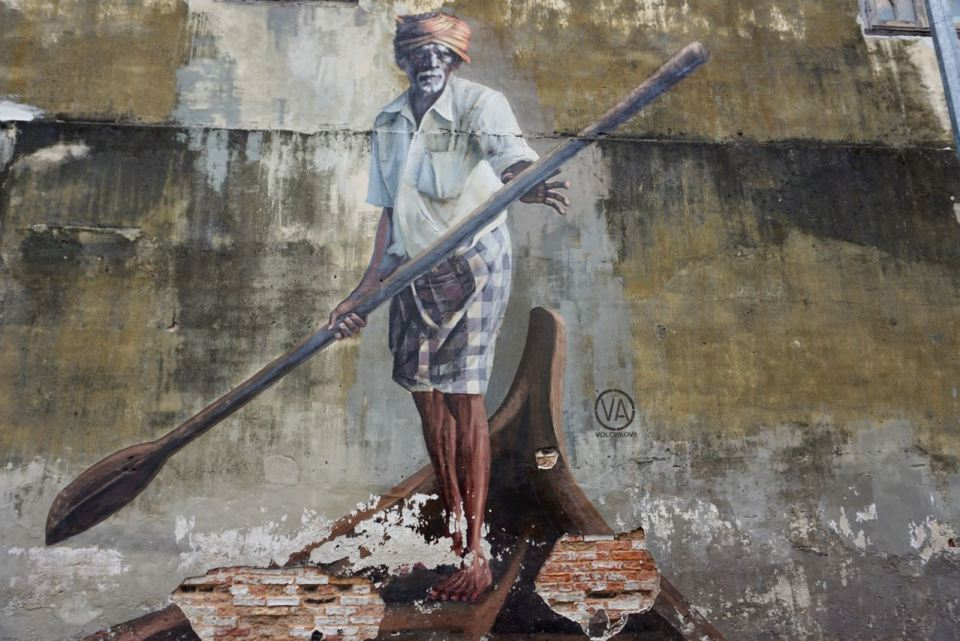 "Streetart ""Fischer"" an einer Wand"