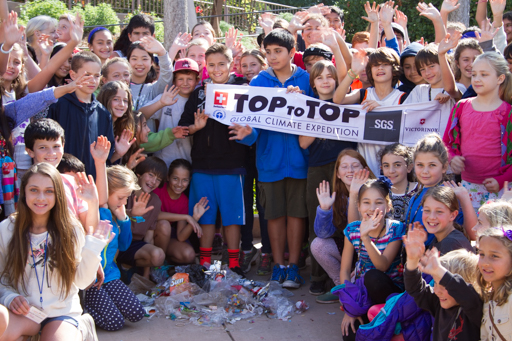 2015-02-04_usa-santa-barbara_hope-school-students-showing-clean-up-results-with-flag-close-up.jpg