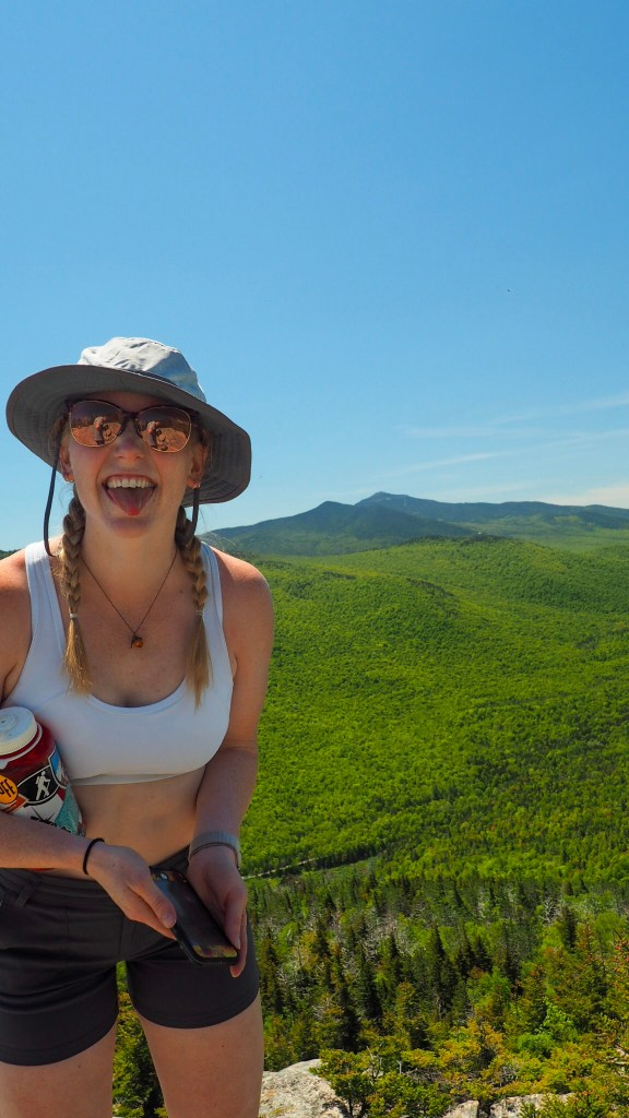 hikin challenge nearly completed! girl sticks her tongue out with a smile on top of Catamount