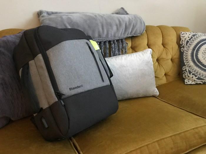 Daily Backpack sitting on velvet couch