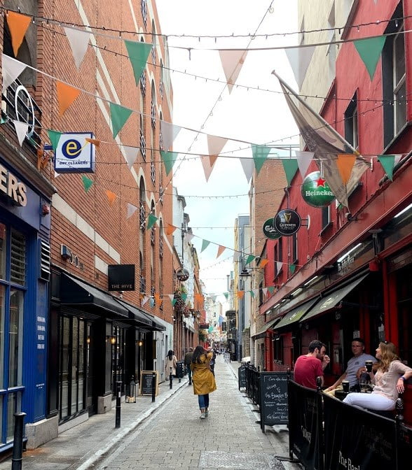 Woman walking down an alley in Dublin's Temple Bar