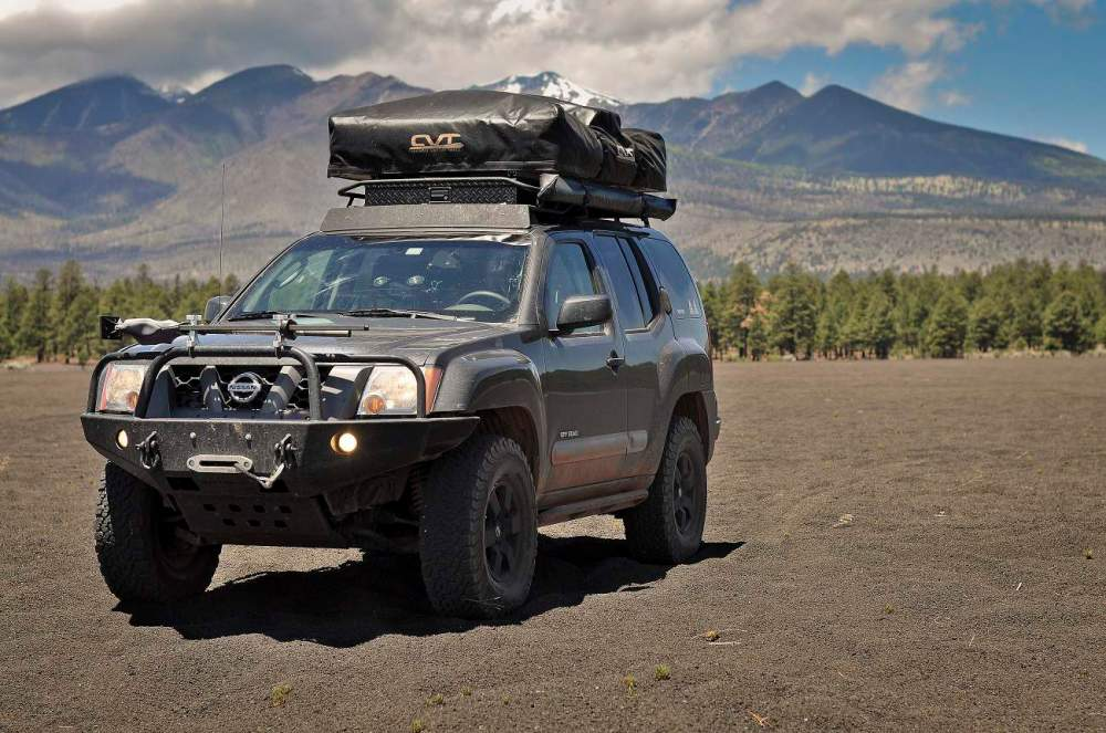 medium resolution of the most recent mod to the xterra is a complete 100 watt solar kit by renology in a somewhat brave moment joel drilled into his factory hood to mount the