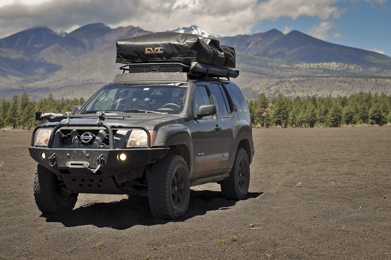 hight resolution of the most recent mod to the xterra is a complete 100 watt solar kit by renology in a somewhat brave moment joel drilled into his factory hood to mount the