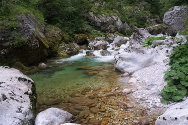 Alabaster white stones and emerald-green water