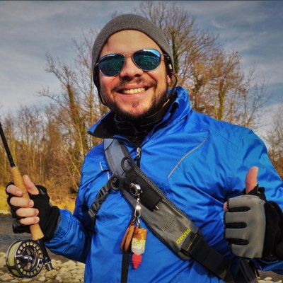 Happy angler with the Orvis waterproof sling pack