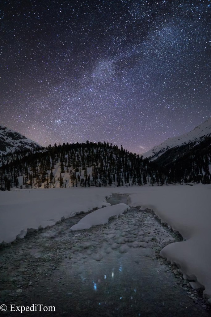 Milky Way ascending in the Swiss Alps reflected in the creek