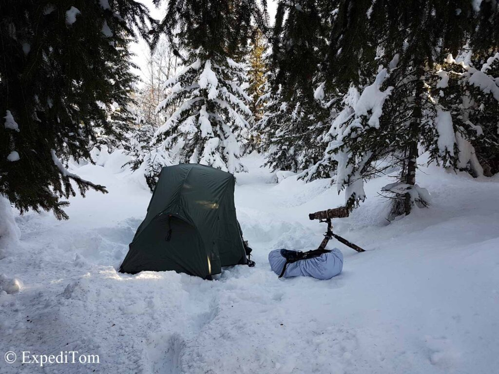 Winter camping sheltered from the wind