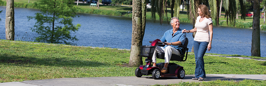 Man in wheelchair by lake