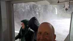 getting wet under the waterfall at Milford Sound