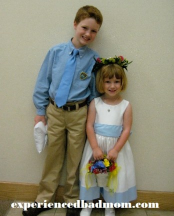 A long time ago the kids BOTH participated in a wedding. Now my son would rather play baseball!
