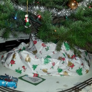 One of my favorite Christmas things: this vinyl tableloth I use as my tree skirt!