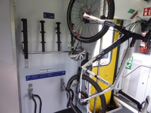 Bikes are placed in numbered racks, panniers removed