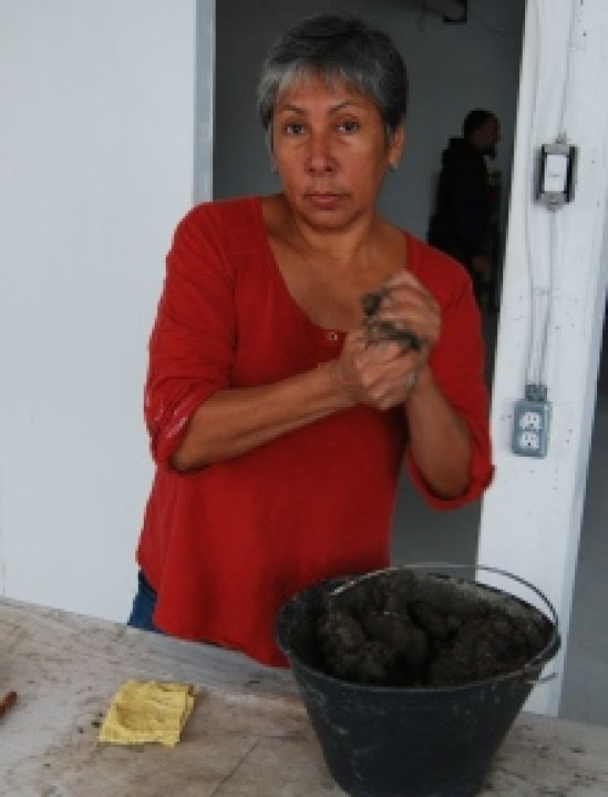 rebecca-belmore-making-clay-beads