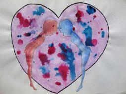 deux silhouettes s'enbrassement devant un coeur
