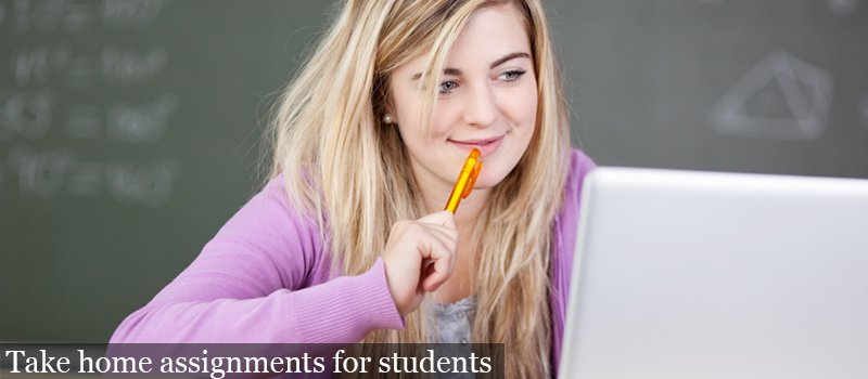 Student_writing_assignment_on_laptop