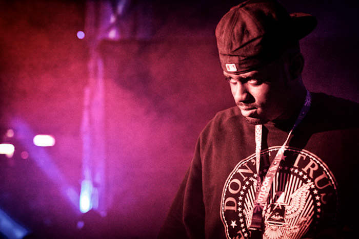 Portrait of a man onstage during a performance, atmospheric purple light behind -understanding shooting modes for photography beginners