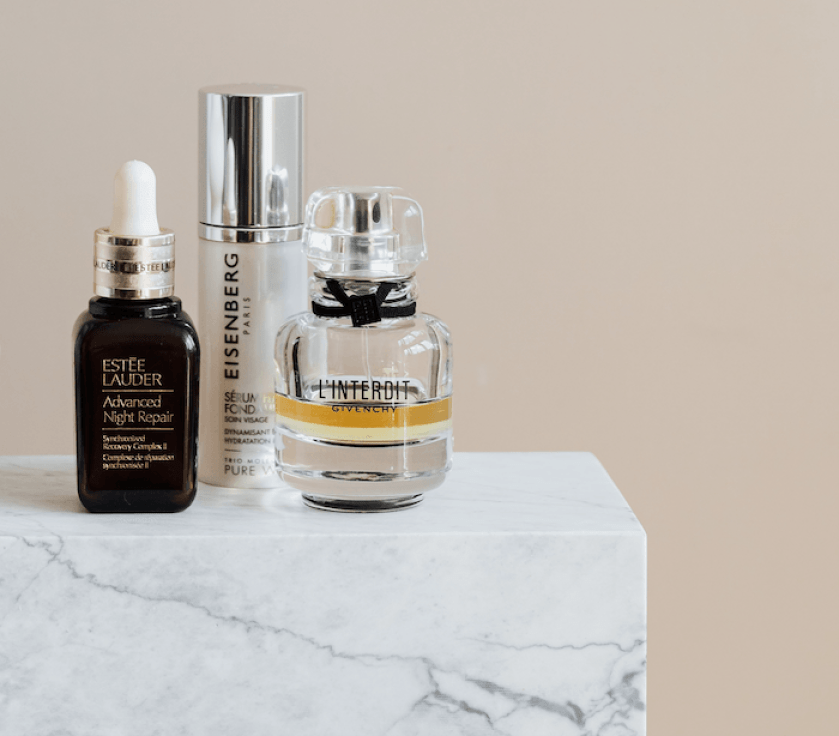 Product photography composition with three bottles