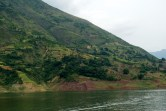 In contrast to the ugly trash in the water, this beautiful countryside was lush and green with terraces and foliage.