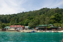 """Perhentian Islands - Pulau Perhentian Besar (""""Big Perhentian Island"""") is lined with resorts and takes nearly an hour by boat to reach. The island is powered by generators that reset once each day in mid-afternoon."""