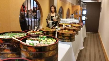 Vice President Beverly Nann checks out the Japanese food