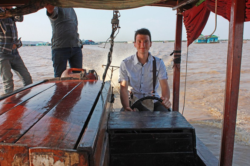 Driving the boat on Lake Tonle Sap, Cambodia