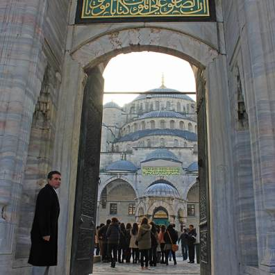 The gate lets us catch a glimpse of the magnificent Blue Mosque in Istanbul, Turkey.