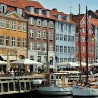 Along the water in Nyhavn, Copenhagen, Denmark - ExplorationVacation.net