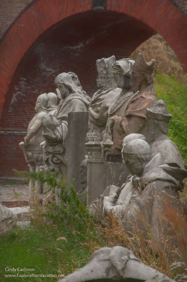 photo painting of broken statues lined up outside