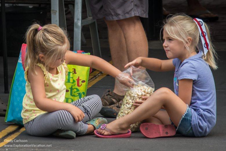 girls eating popcorn Saint Paul farmers market