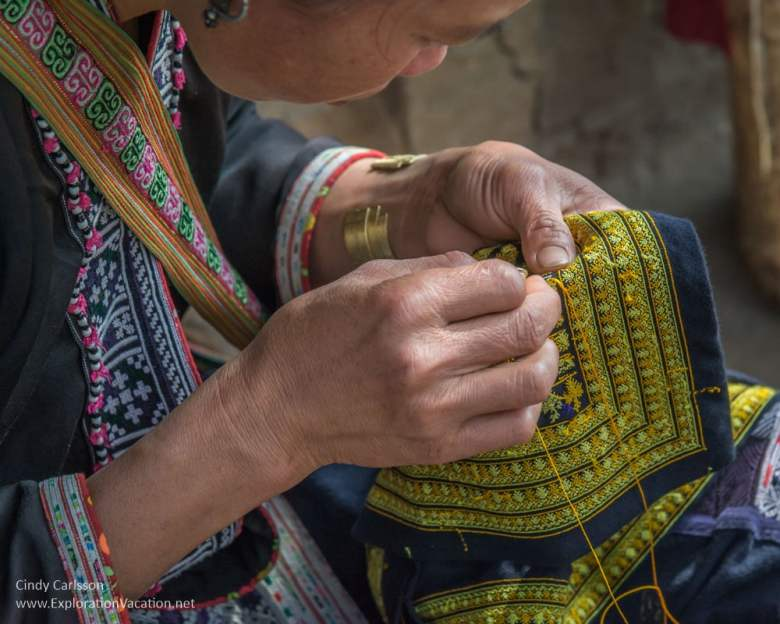 Red Dao woman sewing
