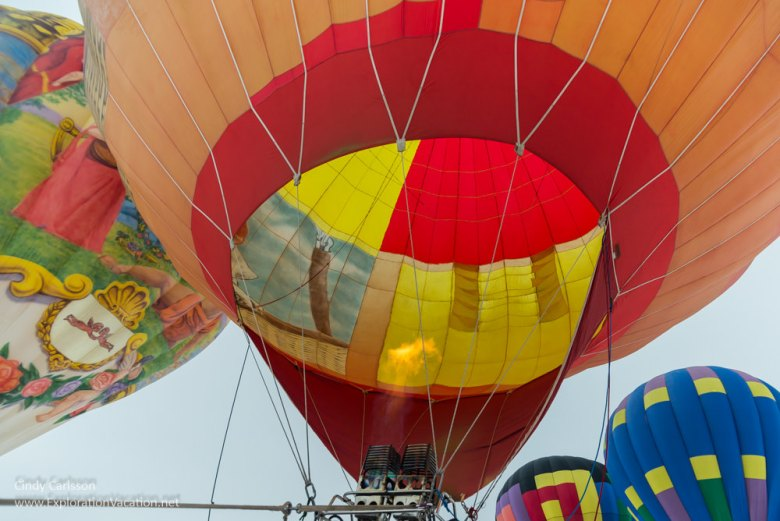 looking up into a balloon with others around