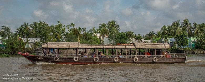 Tourist boat cruising the Mekong Vietnam -ExplorationVacation,net