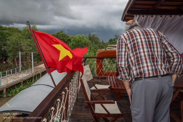 watching for the storm Mekong Delta cruise Vietnam - ExplorationVacation.net