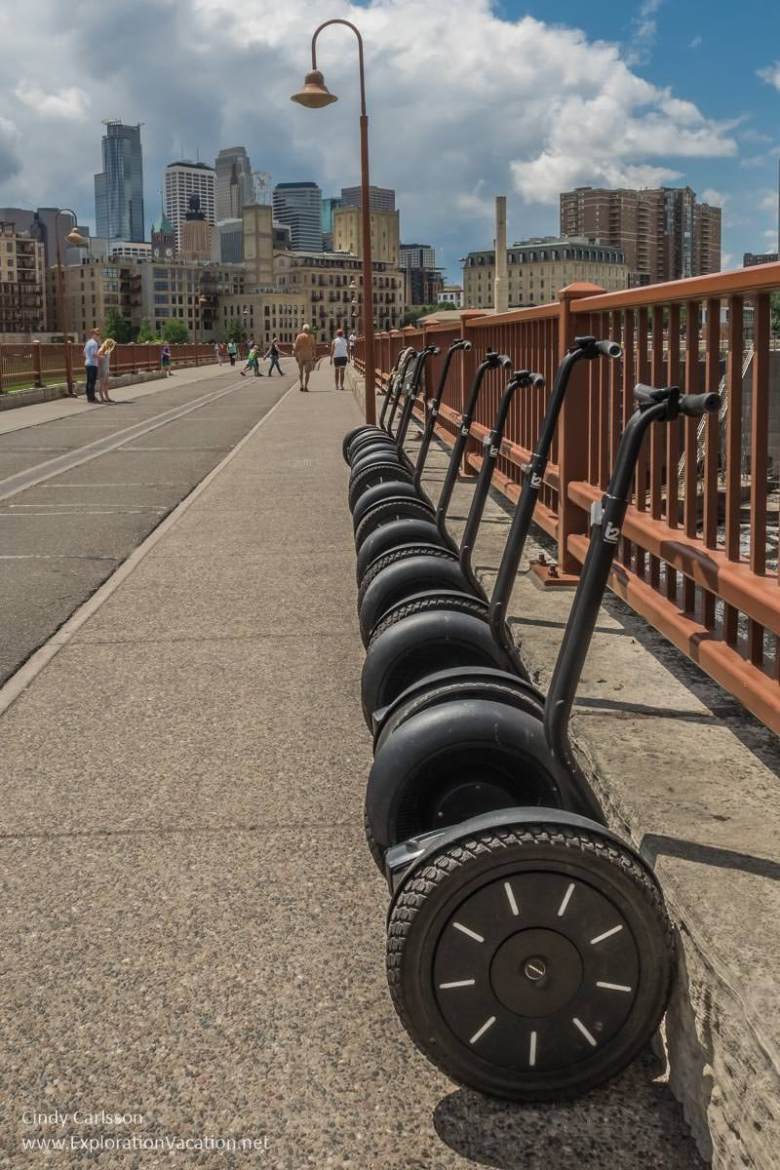 Segways along the Stone Arch Bridge on a tour of the historic Minneapolis Mill District by Segway - ExplorationVacation