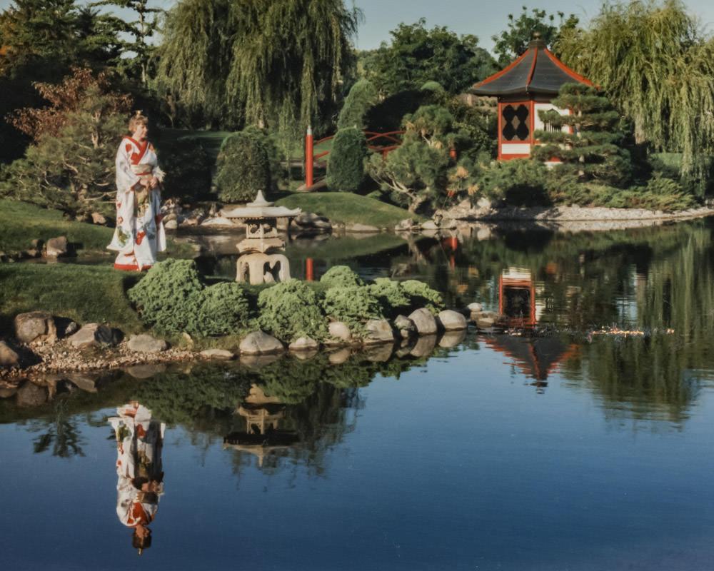 woman in a kimono along the lagoon in Normandale Japanese garden