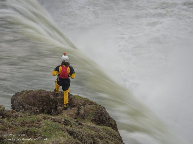 Man standing above a waterfall