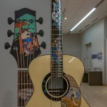 guitar with inlaid Japanese-inspired designs