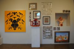 This wall at Eye Lounge features Merkel McKendon, Mimi Jardine, Lee Davis and Constance McBride, among others.