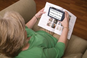 Elderly Woman Using Magnifier