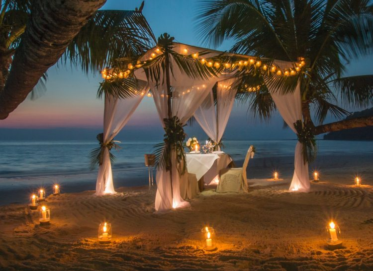 white canopy on Siesta Kaey Beach at night with candles