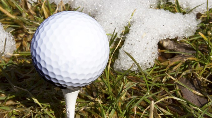 The Masters Logo On A Golf Ball Teed Up On Snowy Grass