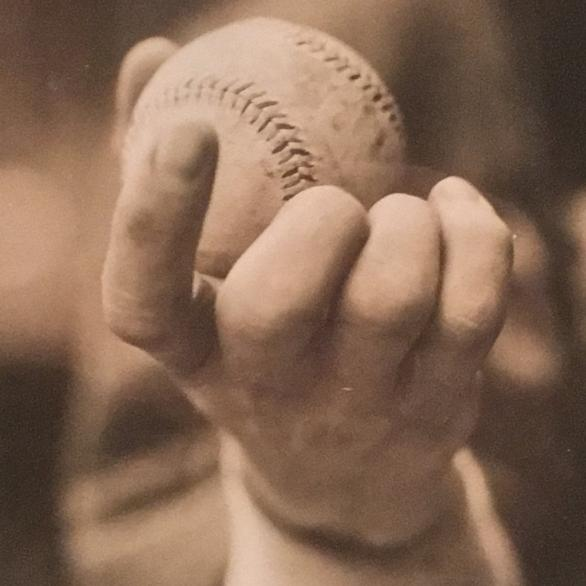 The Knuckleball, a 1913 photo of a baseball held by pitcher Eddie Cicotte