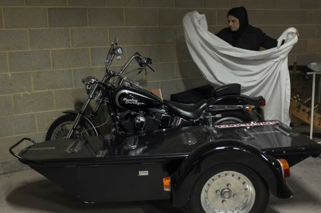 1. Haji Taslim employees prepare shrouding in the ground floor of the East London Mosque for a coffin headed to Cyprus. / 2. Habiba Taslim covers a Harley Davidson hearse with a white cloth.